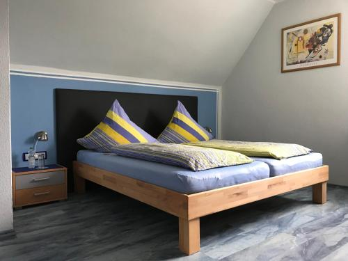 A bed or beds in a room at Bed & Breakfast Pension Legden
