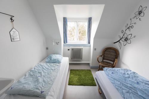 En eller flere senge i et værelse på Fredensborg Vandrerhjem