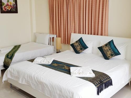 Кровать или кровати в номере Family Guesthouse
