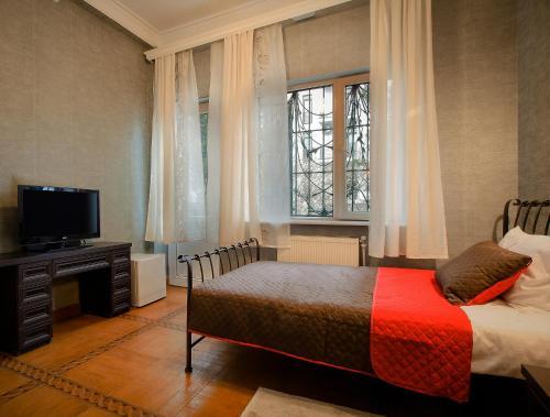 Кровать или кровати в номере Hotel Toma's House