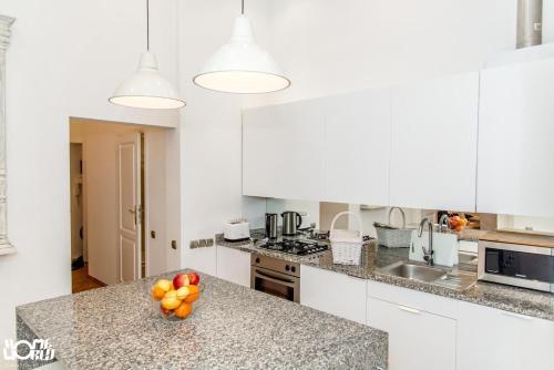 Kuchyňa alebo kuchynka v ubytovaní P&J Apartments Floriańska