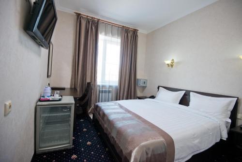 Кровать или кровати в номере Бизнес-отель Европа