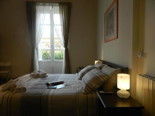 Letto o letti in una camera di La Finestra sul Massimo