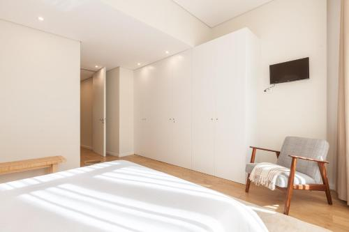 A bed or beds in a room at Bracara's Wall Apartment - Minho's Guest