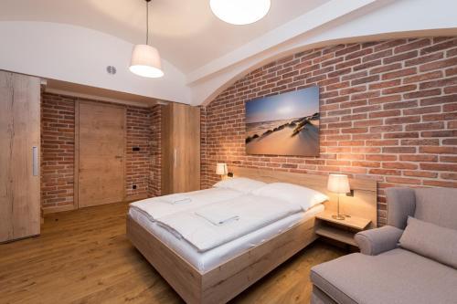 Letto o letti in una camera di Na Skalce Astra Apartment