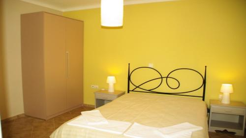 A bed or beds in a room at Elea