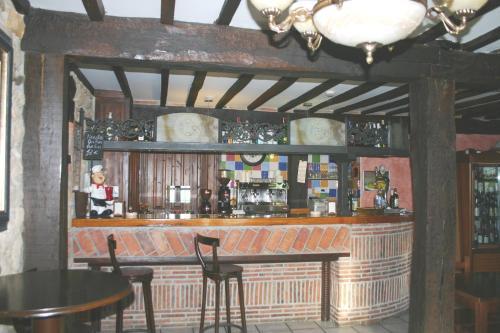 The lounge or bar area at Posada La Venta de Quijas