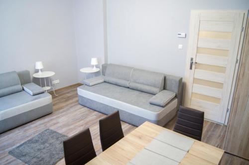 A seating area at Apartamenty Centrum Chodzież