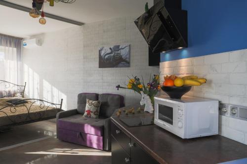 A kitchen or kitchenette at LoftModern (Alisa and Einstein)