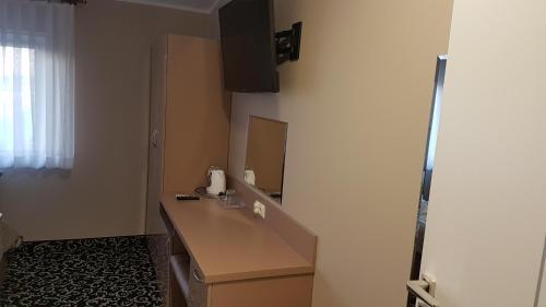 Telewizja i/lub zestaw kina domowego w obiekcie Hotel Gutland