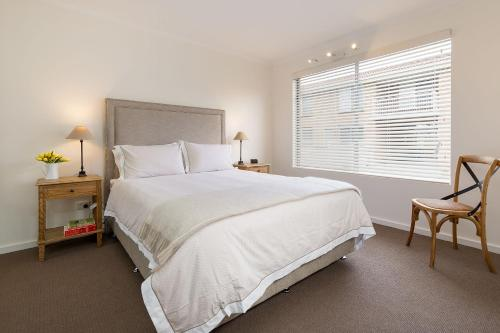 A bed or beds in a room at The Executive - Central & Sophisticated