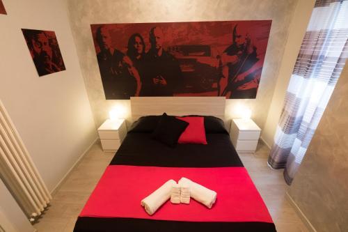 Un ou plusieurs lits dans un hébergement de l'établissement B&B Movie Home