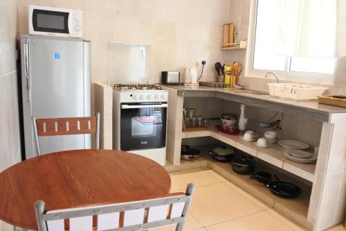 A kitchen or kitchenette at Pension Fidèle