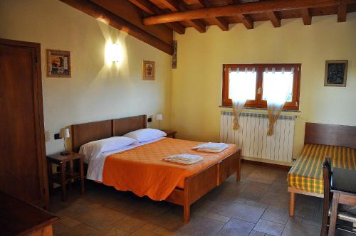 A bed or beds in a room at Azienda Agrituristica Armea