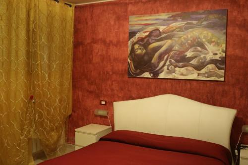 A bed or beds in a room at Le Sirene Bed and Breakfast