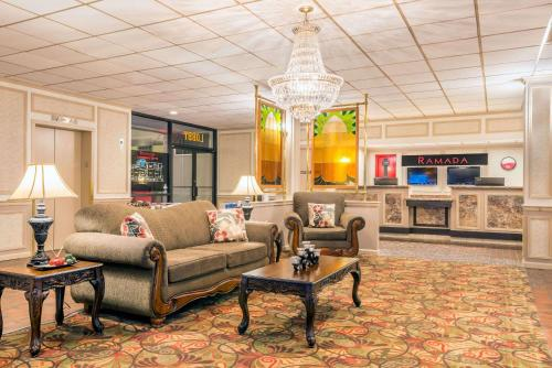 The lobby or reception area at Ramada by Wyndham Paintsville Hotel & Conference Center