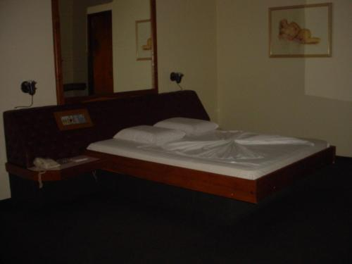 A bed or beds in a room at Motel Prive