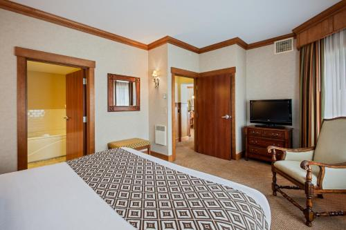 A bed or beds in a room at Crowne Plaza Lake Placid, an IHG Hotel
