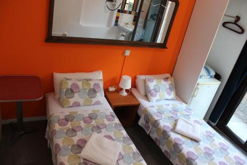Cama o camas de una habitación en Pensión Arosa