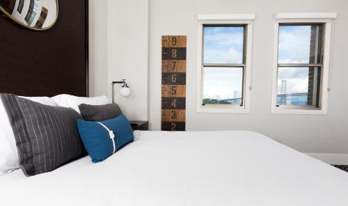 A bed or beds in a room at Harbor Court Hotel