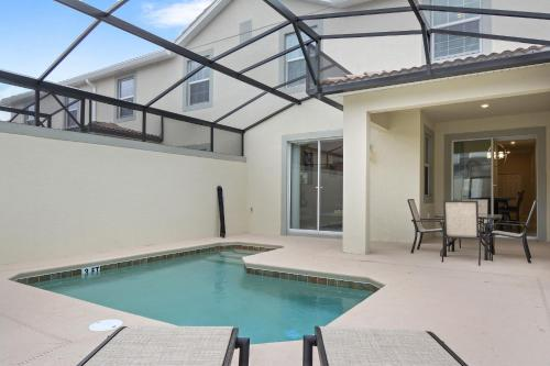 The swimming pool at or close to Four Bedrooms close to Disney w Pool 4898