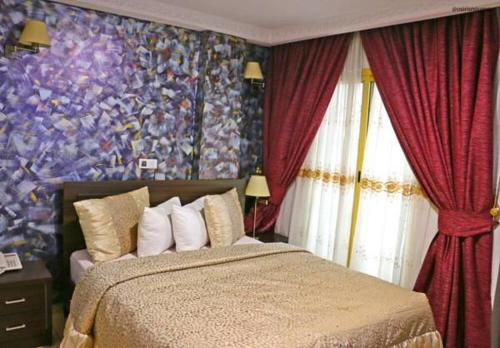 A bed or beds in a room at Noubou International Hotel
