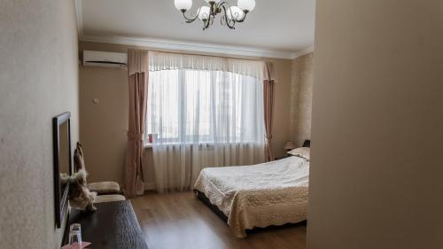 Кровать или кровати в номере Hotel Edem on Repina 52