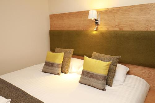 A bed or beds in a room at The Famous Star Hotel Moffat