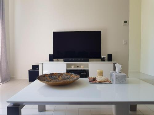 A television and/or entertainment center at New Spacious Beachside townhouse