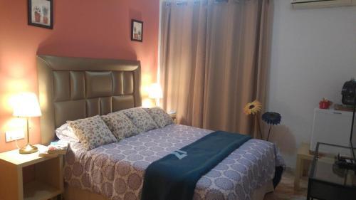 Кровать или кровати в номере Hospederia V Centenario