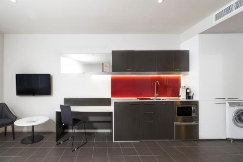 A kitchen or kitchenette at Abode Woden