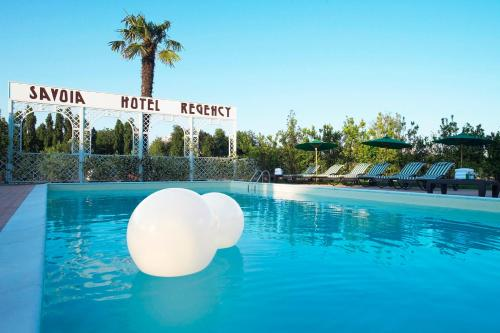 The swimming pool at or near Savoia Hotel Regency