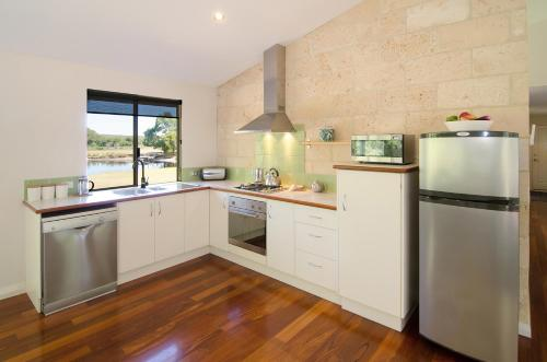 A kitchen or kitchenette at Acacia Chalets Margaret River