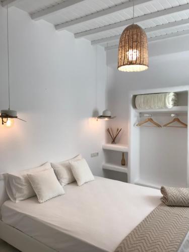 Ένα ή περισσότερα κρεβάτια σε δωμάτιο στο Mykonos Unique Apartment