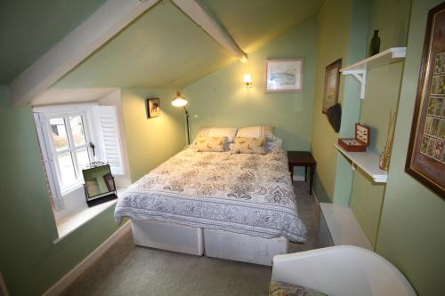 A bed or beds in a room at 14 Bridge Street