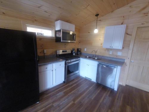 A kitchen or kitchenette at Edinboro Lake Resort Cabins