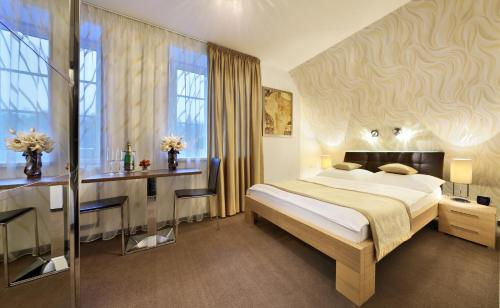 A bed or beds in a room at CK Pension