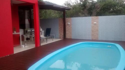 The swimming pool at or close to Casa com piscina para a temporada - cod 31