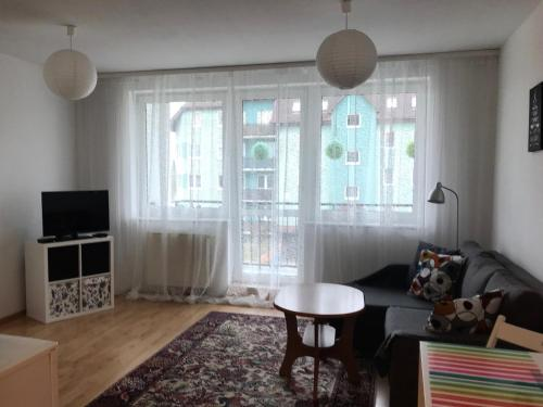 A seating area at Apartament Szczecin Przecław – Zielone Pole