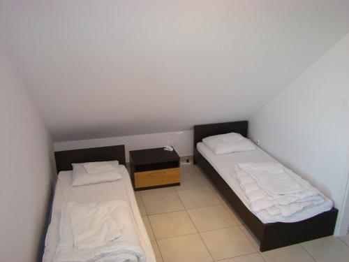A bed or beds in a room at Mylin