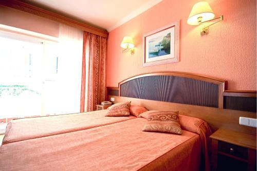 Een bed of bedden in een kamer bij Hotel Manaus