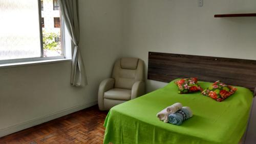 A bed or beds in a room at Luiz & Cristiana Sampaio