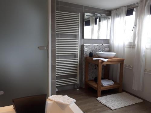A bathroom at Sleep Well Ness Domburg