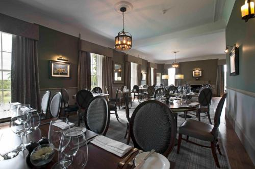 A restaurant or other place to eat at Meldrum House Hotel Golf And Country Estate