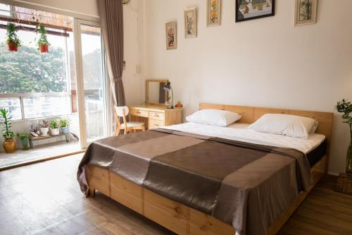 A bed or beds in a room at Kim Lien's Homestay