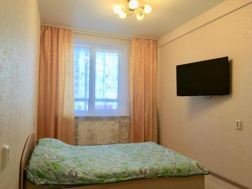 Кровать или кровати в номере Apartment on Lenina 198