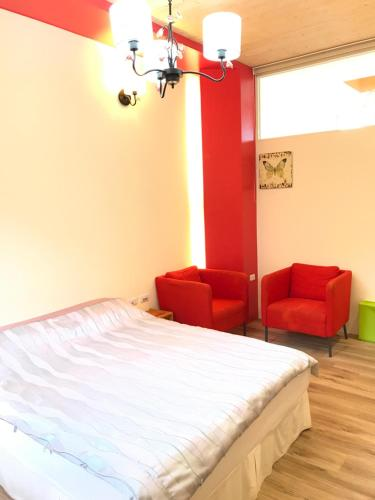 A bed or beds in a room at Saint Malo Homestay