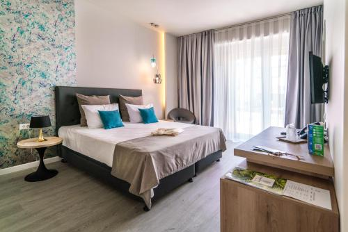 A bed or beds in a room at Nayino Resort Hotel