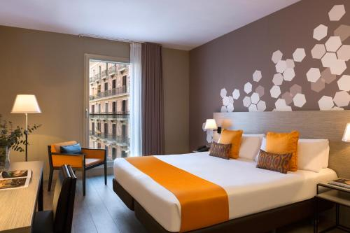 A bed or beds in a room at Citadines Ramblas Barcelona
