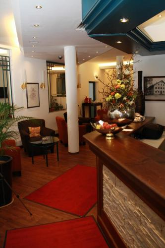 The lobby or reception area at Stadthotel Berggeist